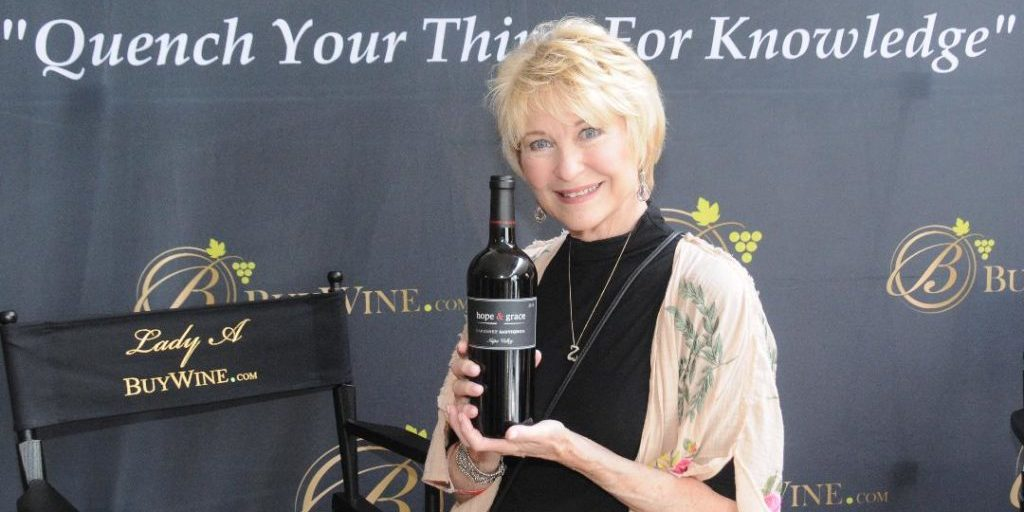 Dee Wallace, forever known as the mom in ET, with a bottle of Hope & Grace wine.